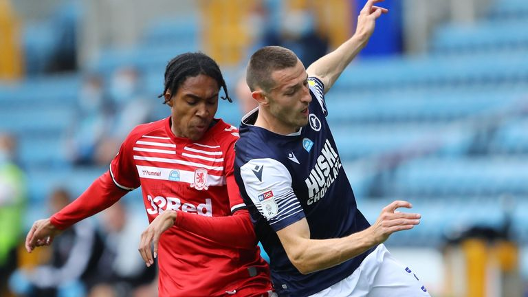 Djed Spence of Middlesbrough is challenged by Murray Wallace of Millwall during the Sky Bet Championship match  at The Den