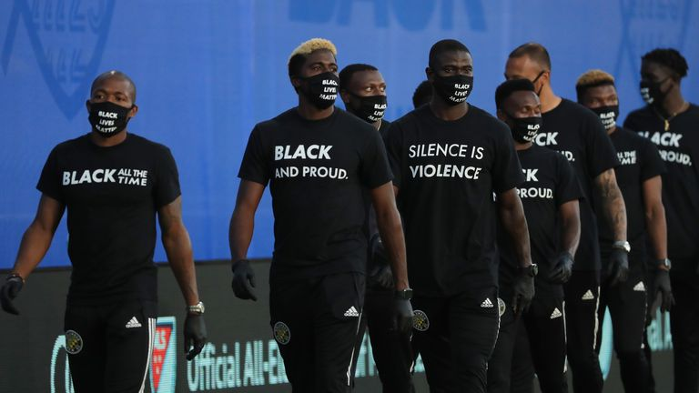 Players of Columbus Crew participate in a Black Lives Matter pre-game ceremony before match between Orlando City and Inter Miami as part of MLS is back Tournament