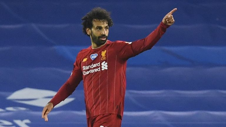 Mohamed Salah of Liverpool celebrates after he scores his side's third goal against Brighton