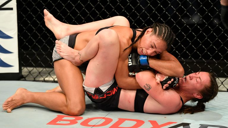 Molly McCann gets an elbow from Talia Santos during their flyweight fight