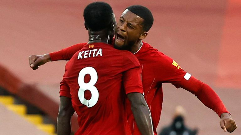 Naby Keita celebrates with Georginio Wijnaldum after putting Liverpool ahead against Chelsea