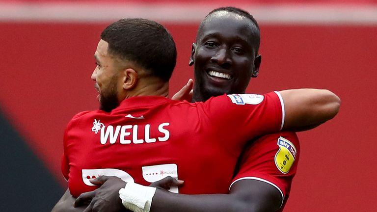 Famara Diedhiou celebrates with Nahki Wells after opening the scoring at Ashton Gate