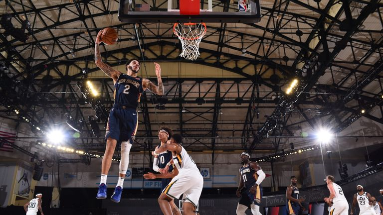 Lonzo Ball #2 of the New Orleans Pelicans grabs the rebound during the game against the Utah Jazz during a game on July 30, 2020 at The HP Field House at ESPN Wide World Of Sports Complex in Orlando, Florida.