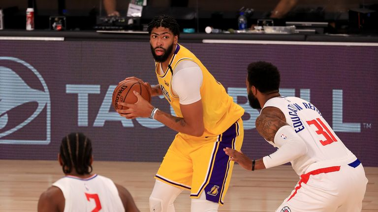 Anthony Davis #3 of the Los Angeles Lakers looks to pass against Marcus Morris Sr. #31 of the LA Clippers during the third quarter of the game at The Arena at ESPN Wide World Of Sports Complex on July 30, 2020 in Lake Buena Vista, Florida.