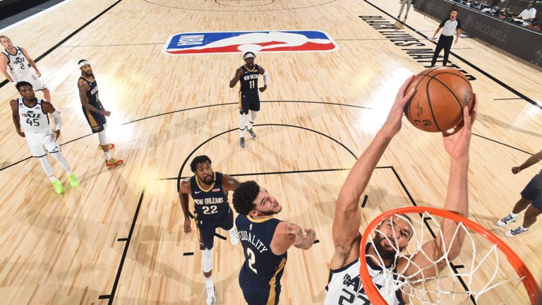 Rudy Gobert #27 of the Utah Jazz dunks the ball during the game against the New Orleans Pelicans during a game on July 30, 2020 at The HP Field House at ESPN Wide World Of Sports Complex in Orlando, Florida.
