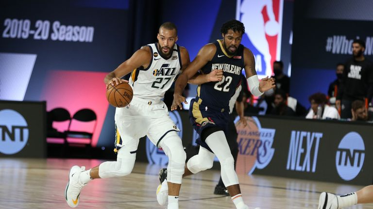 Rudy Gobert #27 of the Utah Jazz handles the ball against the New Orleans Pelicans on July 30, 2020 at HP Field House at ESPN Wide World of Sports in Orlando, Florida.