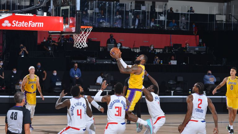 LeBron James #23 of the Los Angeles Lakers shoots the ball to take the lead against the LA Clippers on July 30, 2020 at The Arena at ESPN Wide World Of Sports Complex in Orlando, Florida.