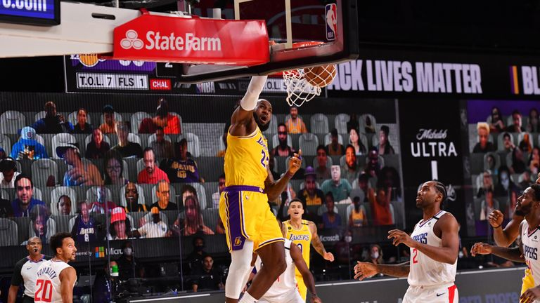 LeBron James #23 of the Los Angeles Lakers dunks the ball against the LA Clippers on July 30, 2020 at The Arena at ESPN Wide World Of Sports Complex in Orlando, Florida.
