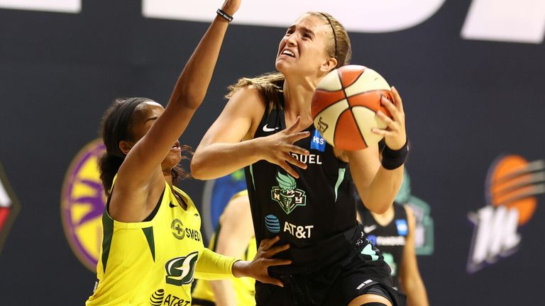 Sabrina Ionescu attacks the basket against the Seattle Storm