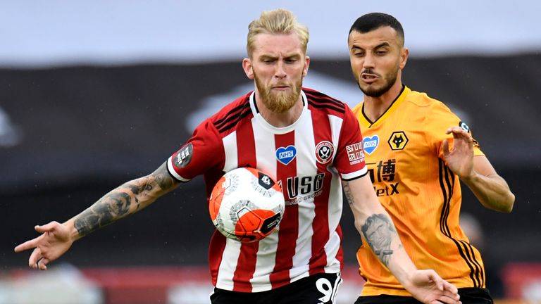 Sheffield United's Oliver McBurnie (left) and Wolverhampton Wanderers' Romain Saiss battle for the ball