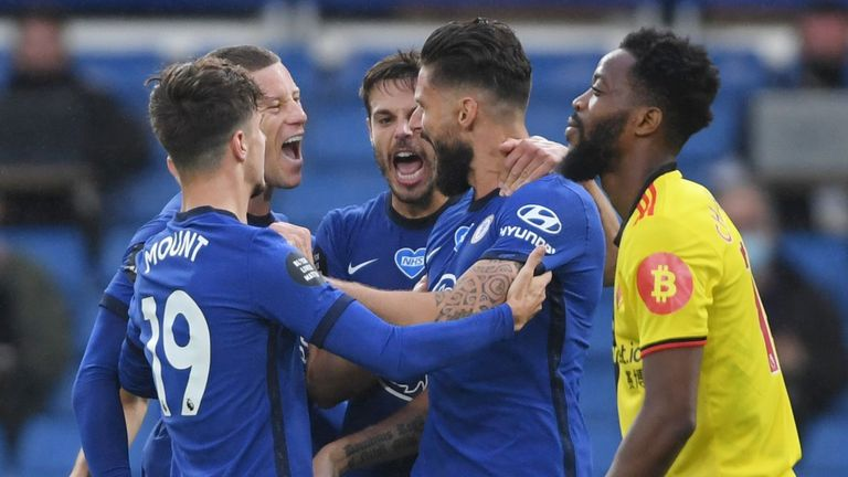 Olivier Giroud celebrates with team-mates after giving Chelsea the lead against Watford