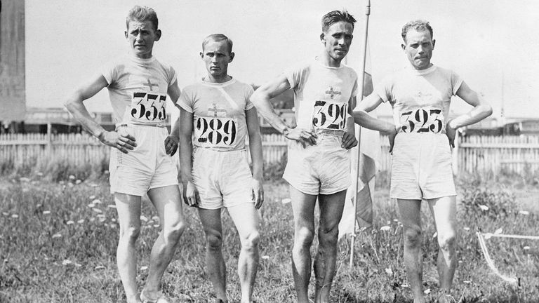 The victorious Finnish cross-country team poses at the 1924 Paris Olympics