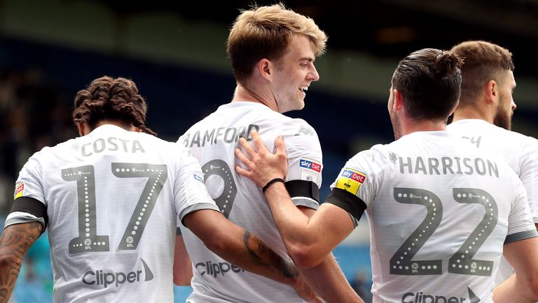 Leeds United's Patrick Bamford (centre) and his team-mates celebrate their side's first goal of the game which was an own goal scored by Barnsley's Michael Sollbauer