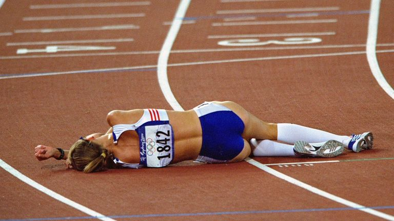 Radcliffe lies on the track after being outpaced on the final lap of the 10,000m final in Sydney