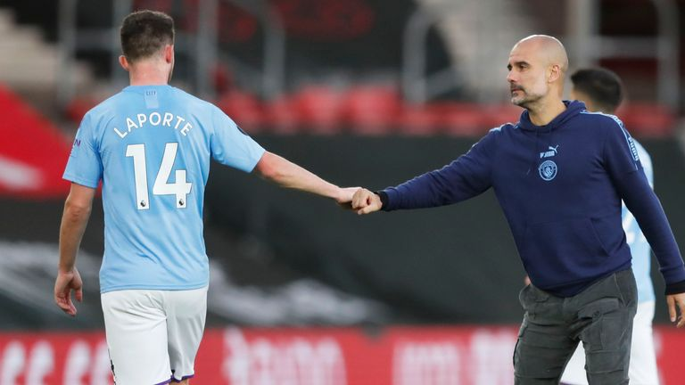 Aymeric Laporte and Guardiola shake hands after a ninth league defeat