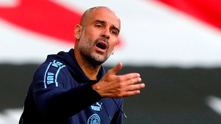 Pep Guardiola cuts a frustrated figure on the sidelines as his City side are beaten
