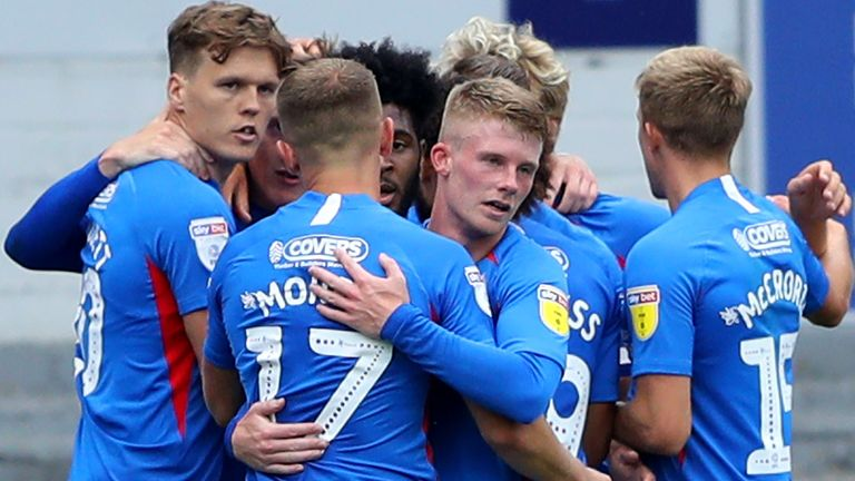 Portsmouth players celebrate after Ronan Curtis' opening goal