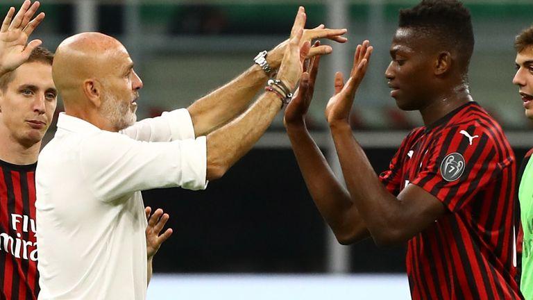 Goalscorer Rafael Leo celebrates with Stefano Pioli at full time