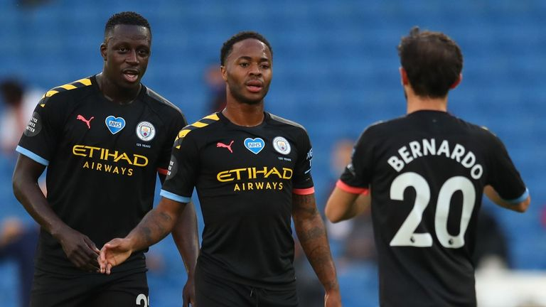 Raheem Sterling celebrates after opening the scoring for Manchester City at Brighton