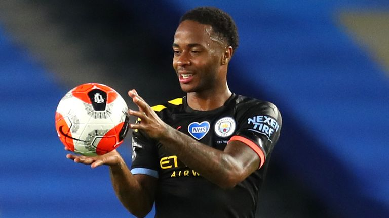 Manchester City's Raheem Sterling with his hat-trick match ball after the final whistle during the Premier League match at the Amex Stadium, Brighton