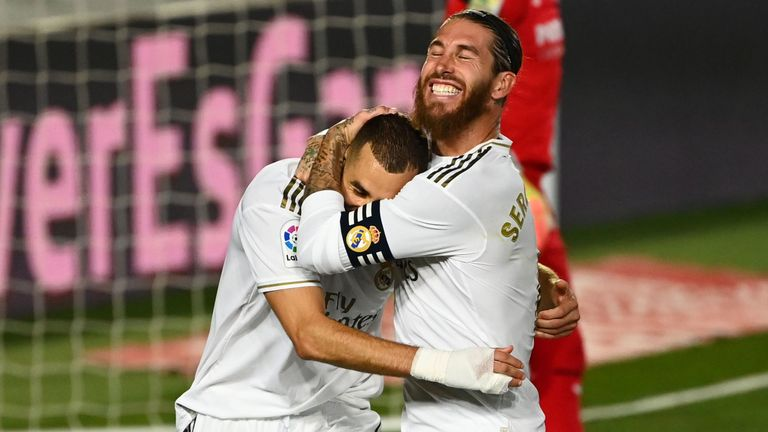 Sergio Ramos hugs Karim Benzema after he scores a penalty for Real Madrid against Villarreal