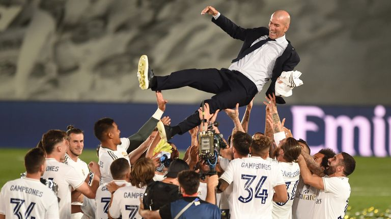 Real Madrid head coach Zinedine Zidane is thrown up in the air by his players after Madrid secure the La Liga title