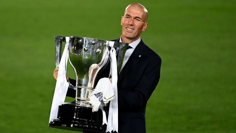 Real Madrid head coach Zinedine Zidane with La Liga trophy