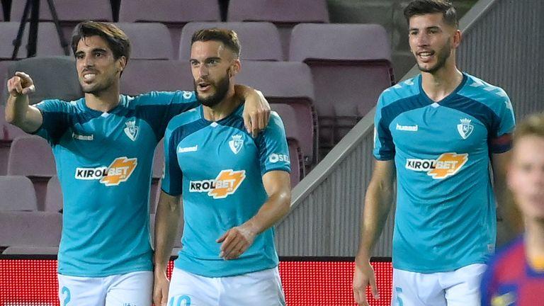 Roberto Torres (second left) celebrates his stoppage-time strike for Osasuna