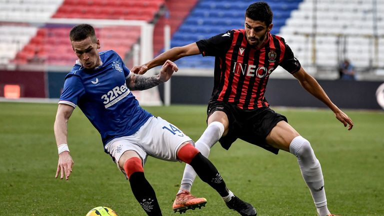 Ryan Kent (L) vies for the ball with Nice midfielder Pierre Lees-Melou