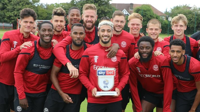 Said Benrahma poses with his Brentford team-mates after winning Sky Bet Championship Player of the Month for July