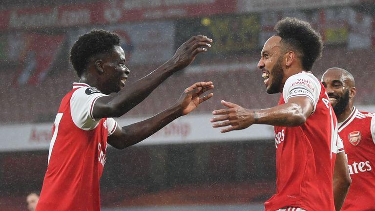 Saka and Aubameyang celebrate Arsenal's opener