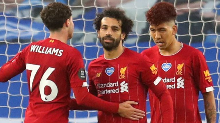 BRIGHTON, ENGLAND - JULY 08: Mohamed Salah of Liverpool celebrates after scoring his teams first goal during the Premier League match between Brighton & Hove Albion and Liverpool FC at American Express Community Stadium on July 08, 2020 in Brighton, England.