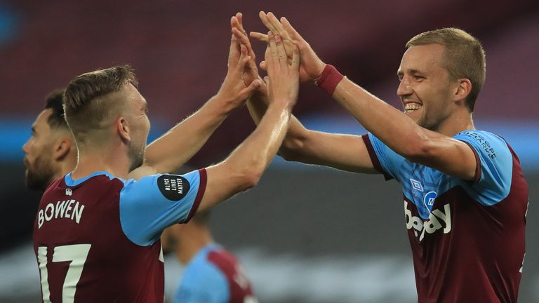 West Ham United's Czech midfielder Tomas Soucek (R) celebrates with teammates after he scores his team's first goal during the English Premier League football match between West Ham United and Chelsea at The London Stadium, in east London on July 1, 2020.