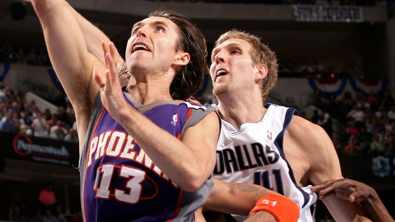 Steve Nash stretches for a lay-up beyond the reach of Dirk Nowitzki