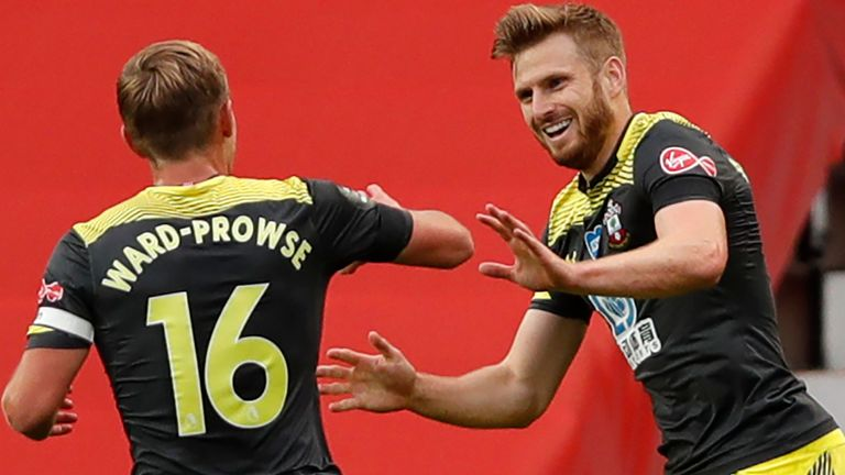 Stuart Armstrong and James Ward-Prowse celebrate after the former gave Southampton the lead at Old Trafford