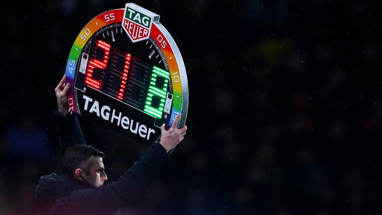 Michael Oliver holds up the Rainbow laces, this is everyones game substitutes board during the Premier League match between Watford FC and Manchester City at Vicarage Road on December 4, 2018 in Watford, United Kingdom.