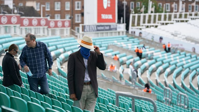 Spectators arrive for the friendly match between Surrey and Middlesex in the first trial of fans in stadiums in England since the coronavirus pandemic
