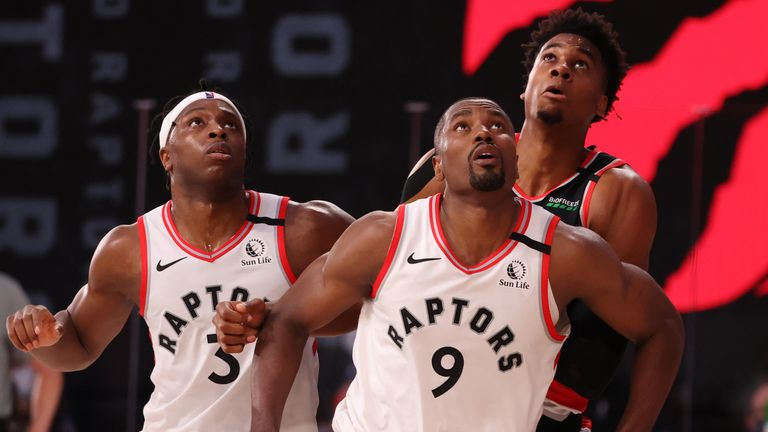 Serge Ibaka and Kyle Lowry contest a rebound with Hassan Whiteside