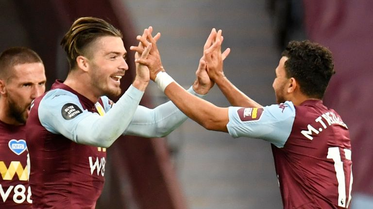 Trezeguet celebrates with Jack Grealish after firing Aston Villa ahead against Arsenal