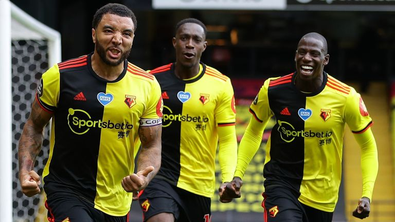 Troy Deeney celebrates with team-mates after scoring Watford's second goal