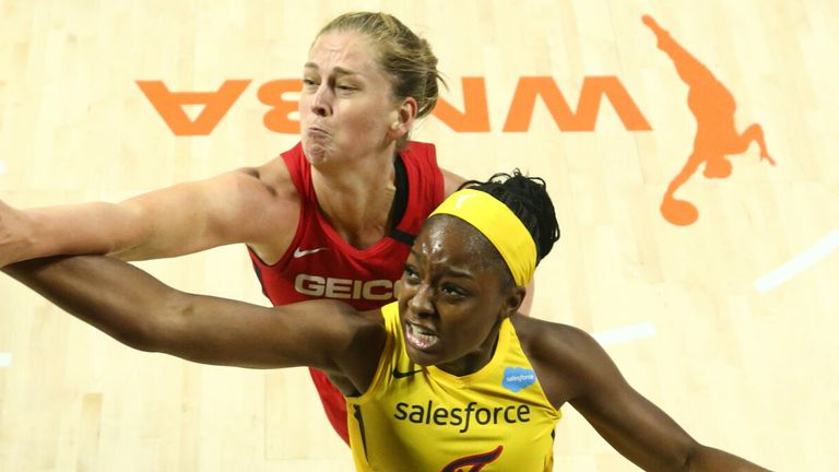 Emma Meesseman competes for a rebound against the Indiana Fever