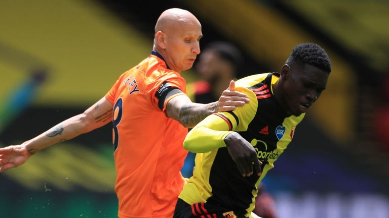 Watford's Ismaila Sarr and Newcastle Jonjo Shelvey battle for the ball
