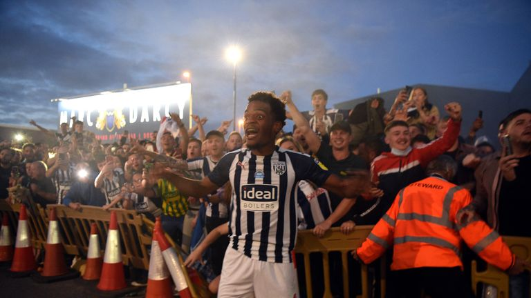 West Brom players celebrated with fans after their promotion