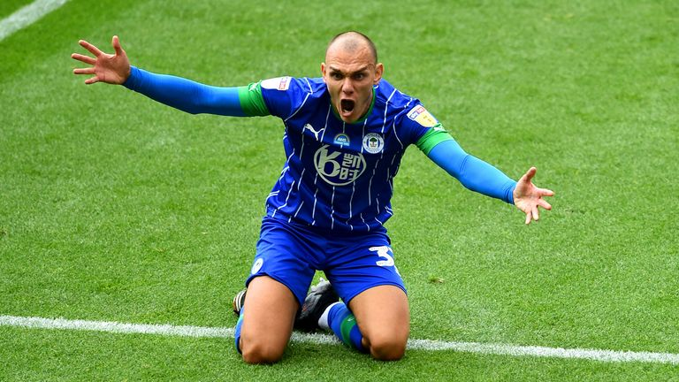 Kal Naismith celebrates putting Wigan 1-0 up in the first minute