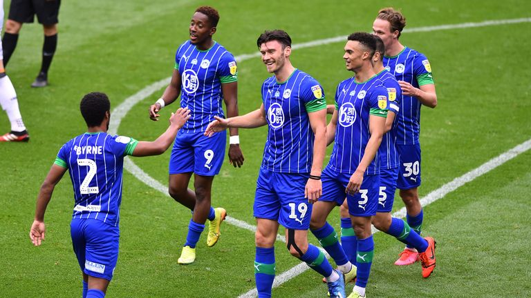Kieffer Moore celebrates his second and Wigan's fifth after 40 minutes