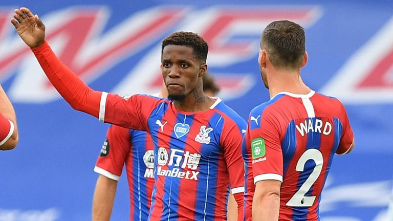 Wilfried Zaha celebrates after scoring for Crystal Palace vs Chelsea