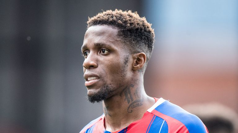 Wilfried Zaha of Crystal Palace looks on during the Premier League match between Crystal Palace and Tottenham Hotspur at Selhurst Park on July 26, 2020 in London, United Kingdom.