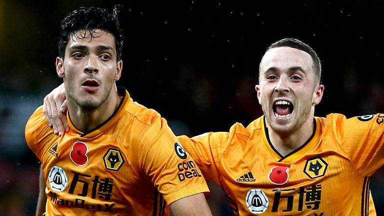 Raul Jimenez of Wolverhampton Wanderers celebrates with teammate Diogo Jota after scoring his team's first goal during the Premier League match between Arsenal FC and Wolverhampton Wanderers at Emirates Stadium on November 02, 2019 in London, United Kingdom. (Photo by Jordan Mansfield/Getty Images)