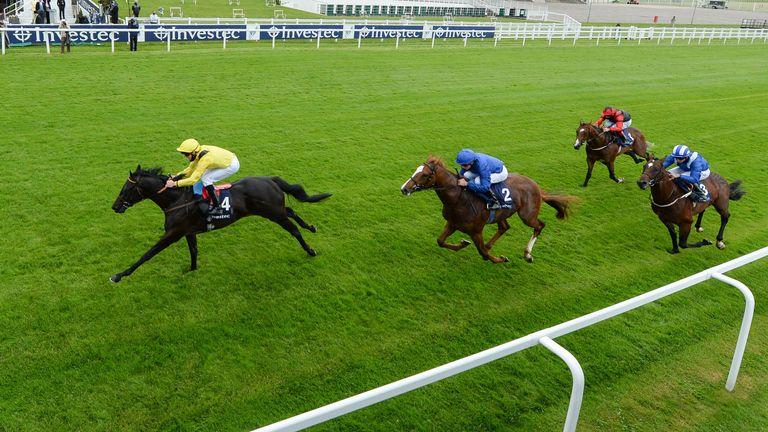 Twassol wins the Woodcote Stakes