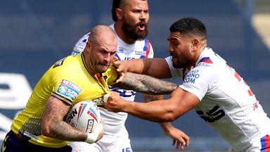 Zak Hardaker is tackled by Wakefield's Kelepi Tanginoa